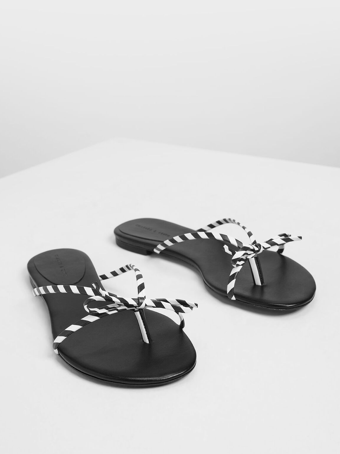 Strappy Bow Black And White Stripe Thong Sandals