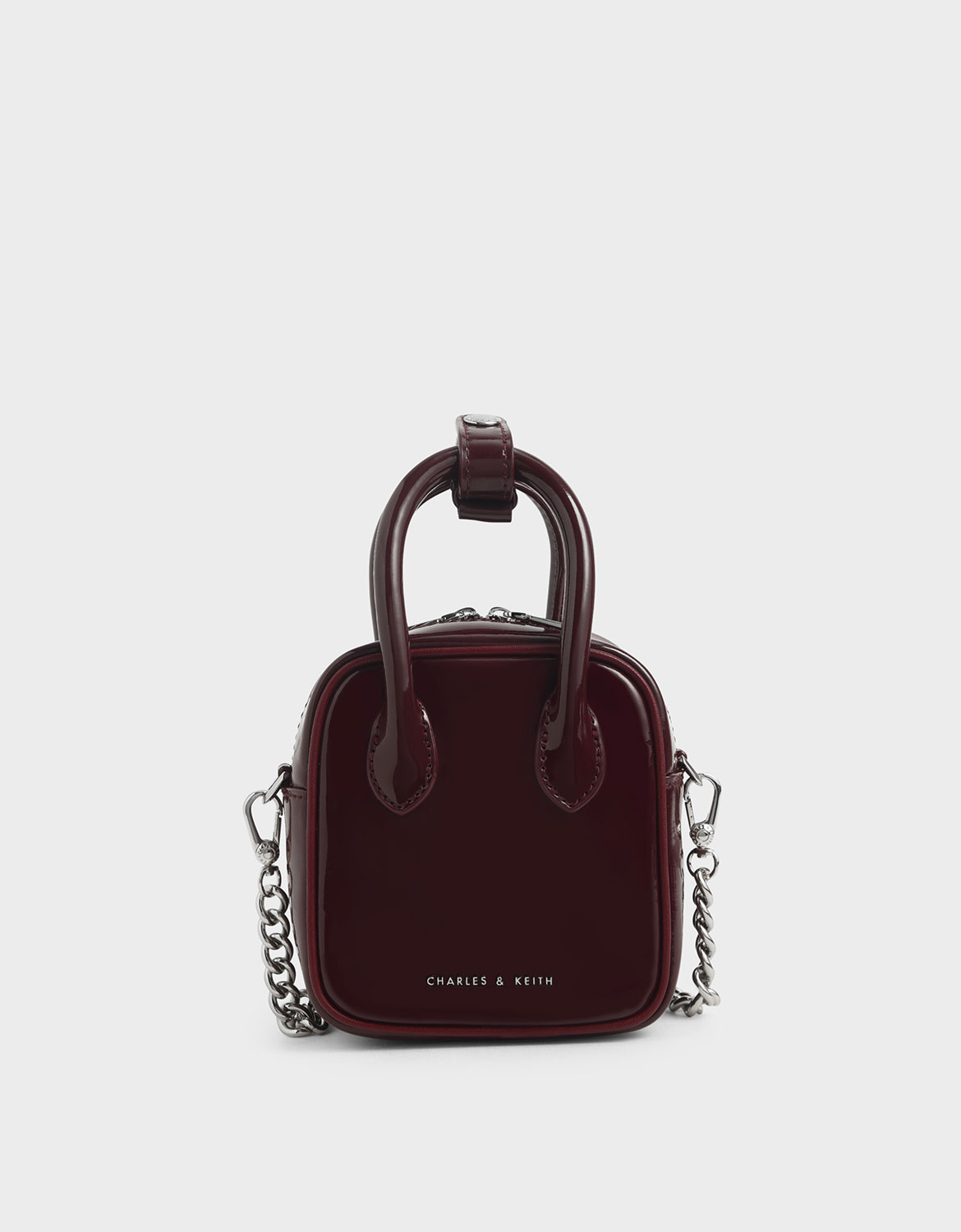 Women's burgundy mini patent square pouch
