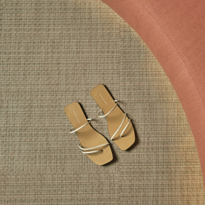 Women's strappy thong sandals in chalk - CHARLES & KEITH