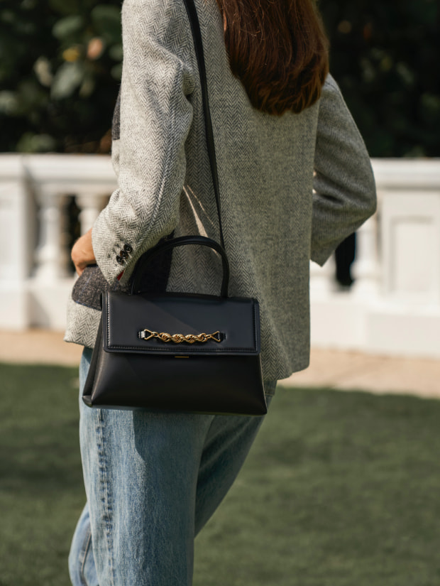 Women's chain-embellished trapeze top handle bag in black - CHARLES & KEITH