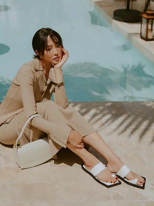 Women's white toe loop slide sandals and cream coiled top handle shoulder bag