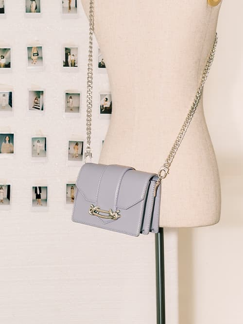 Women's metallic buckle crossbody bag in light blue