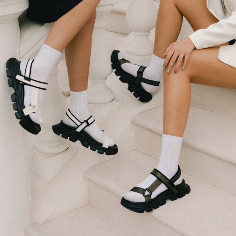 Women's Grosgrain Sports Sandals in white and military green, as seen on Anna and Sonia Kuprienko (close up) - CHARLES & KEITH