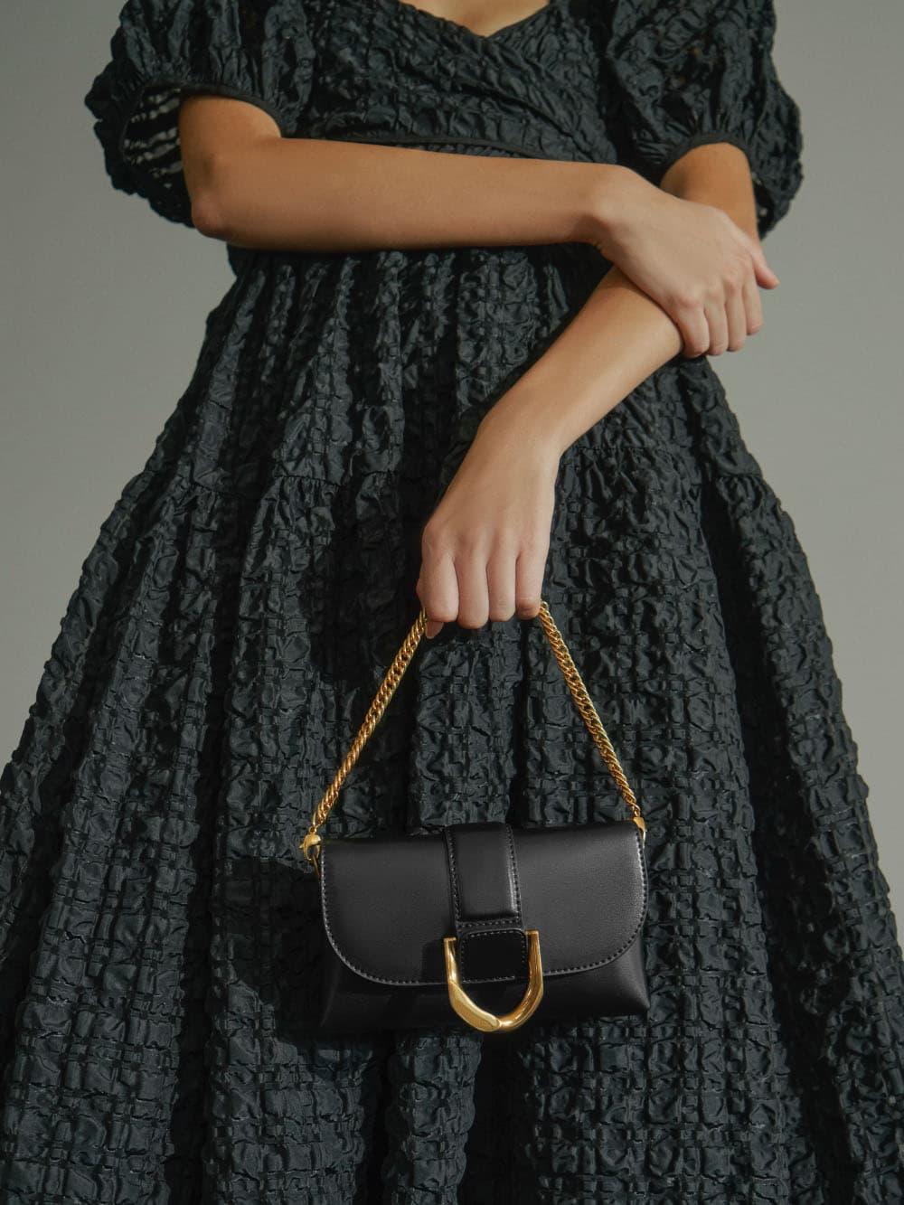 Women's metallic buckle crossbody bag in black - CHARLES & KEITH