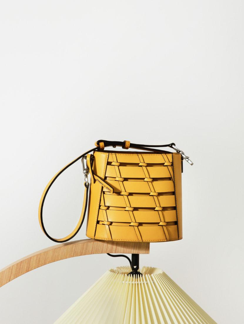 Women's braided bucket bag in yellow - CHARLES & KEITH