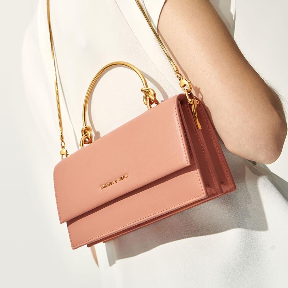 蜜桃色金屬手提長夾、粉紅色拉鍊小收納包 - CHARLES & KEITH