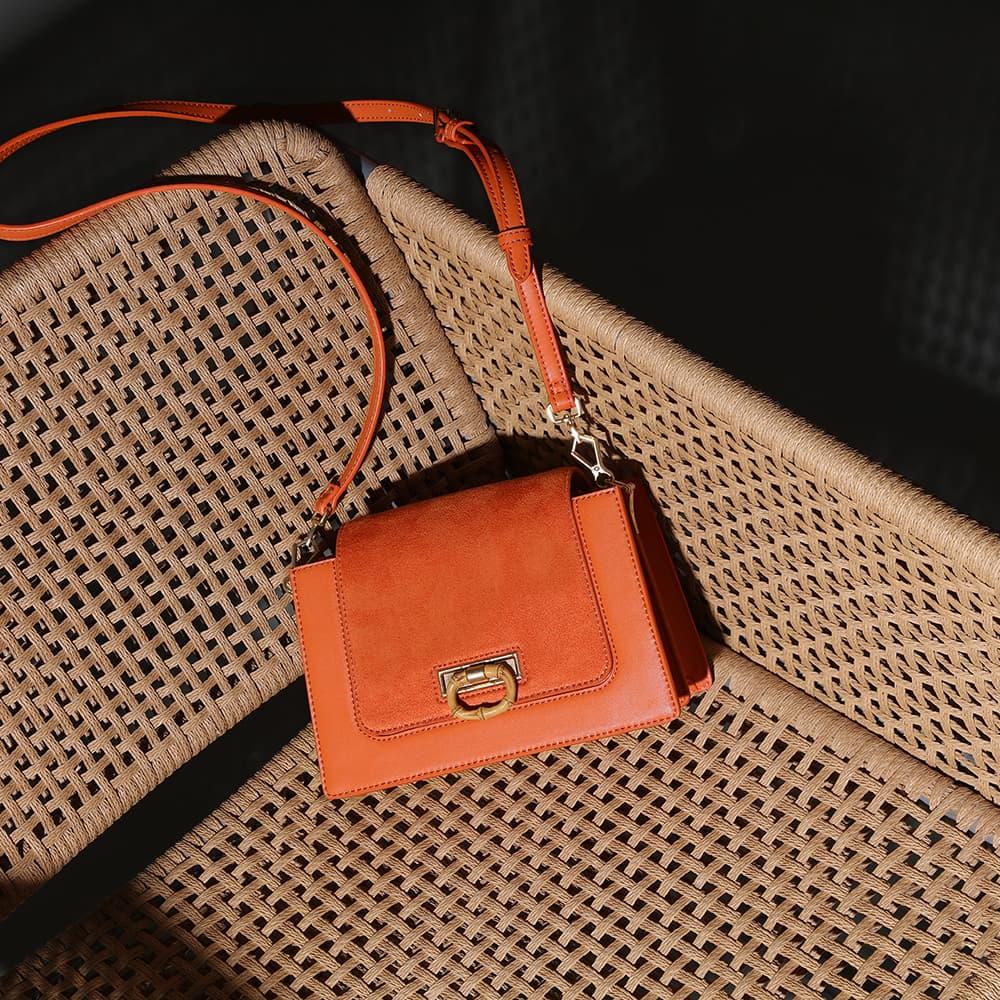 Women's textured crossbody bag in orange - CHARLES & KEITH