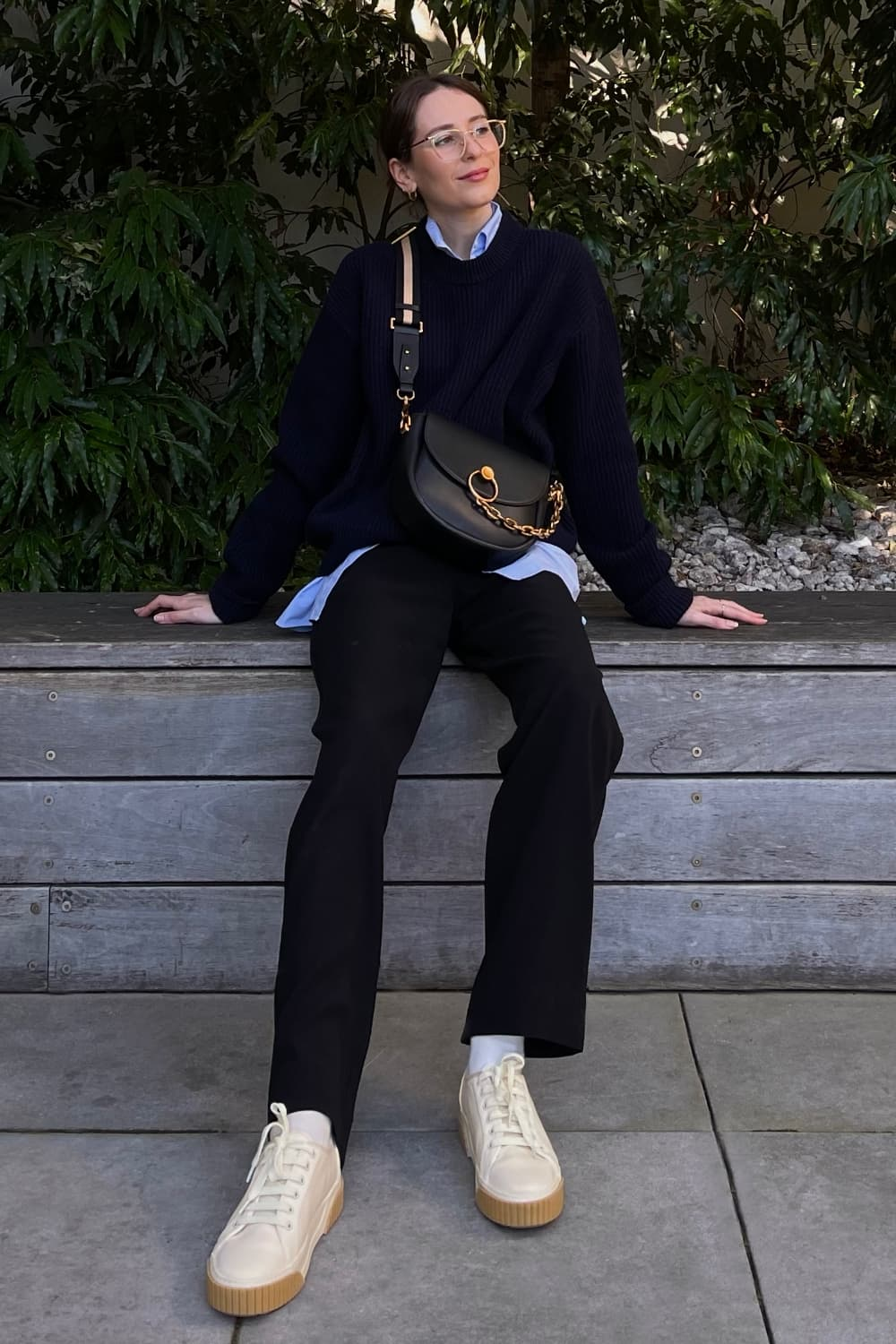 Women's black chunky chain-link saddle bag and cream cotton low-top sneakers, as seen on Jess Alizzi - CHARLES & KEITH