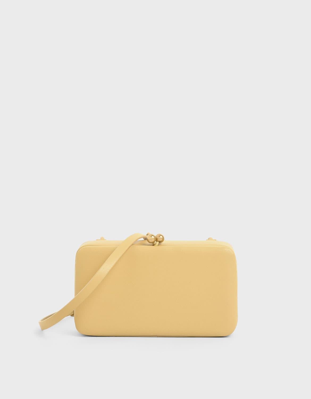 Women's boxy twist lock crossbody bag in yellow – CHARLES & KEITH