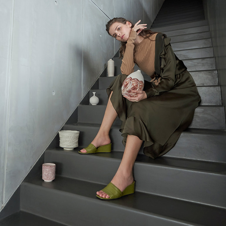 Women's strappy wedges in green (sitting pose) – CHARLES & KEITH