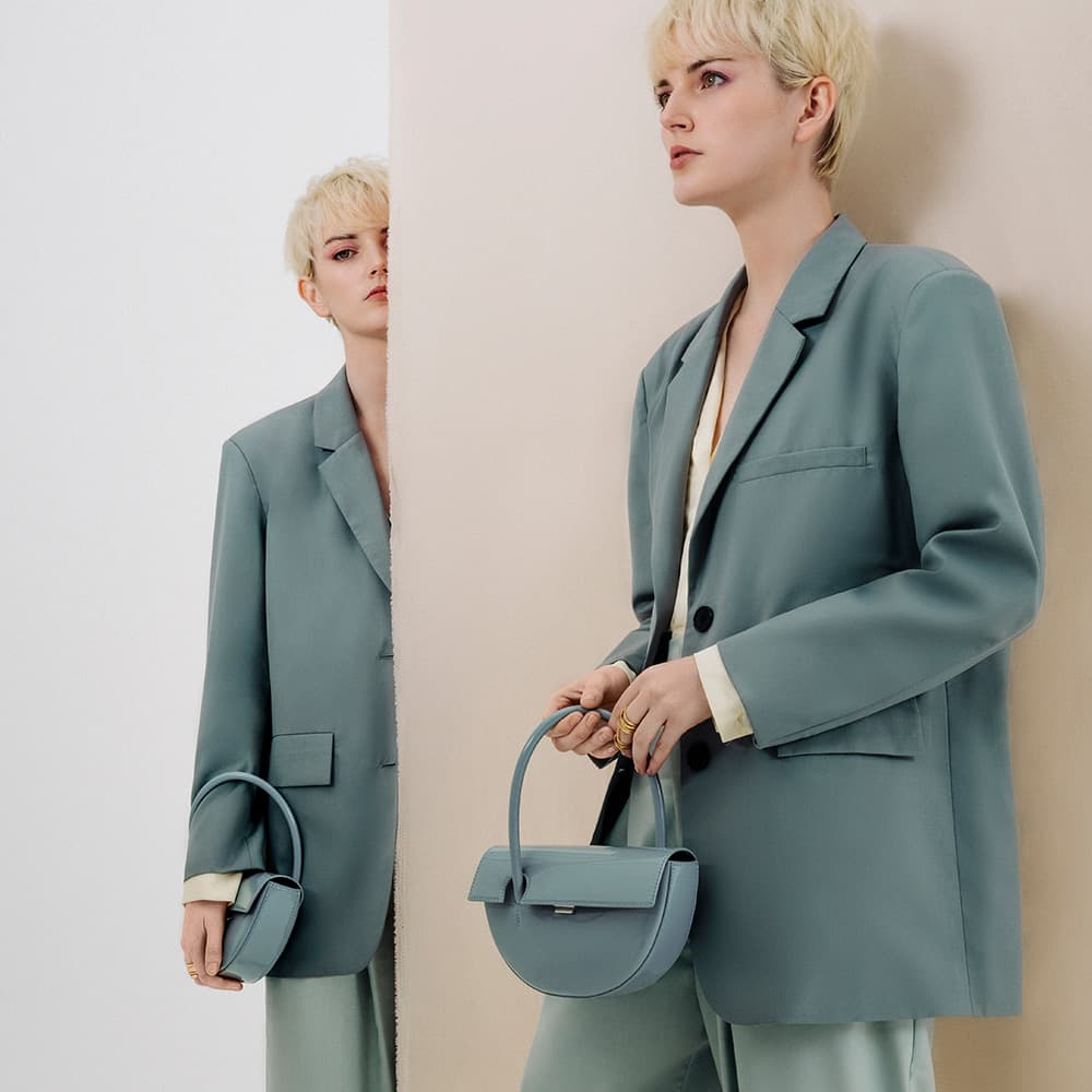 Women's patent top handle semi-circle bag in slate blue and hammered double ring in brush gold - CHARLES & KEITH